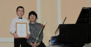 Александр Бирюков с преподавателем Татьяной Полиной.